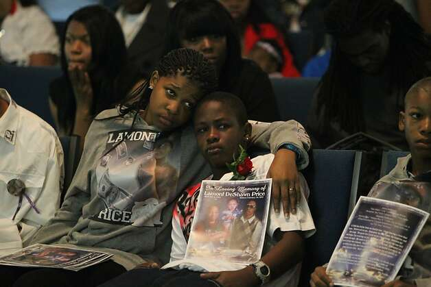 Tajjeunna Price, 15, clings to her brother Armon James, 12, as they listen to people share their memories of their brother Lamont Price during his funeral, Wednesday, February 29, 2012, at Mt. Calvary Baptist Church in Oakland. Photo: Lacy Atkins, The Chronicle