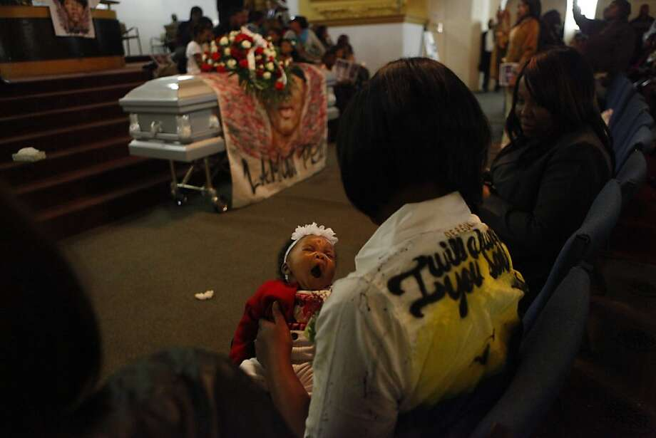 Andrea James, the mother of Lamont Price, holds her grandchild Ka' Maya during Price's funeral service, Wednesday, February 29, 2012, at Mt. Calvary Baptist Church in Oakland. Ka' Maya Price was 6-weeks-old when her father was killed. Photo: Lacy Atkins, The Chronicle