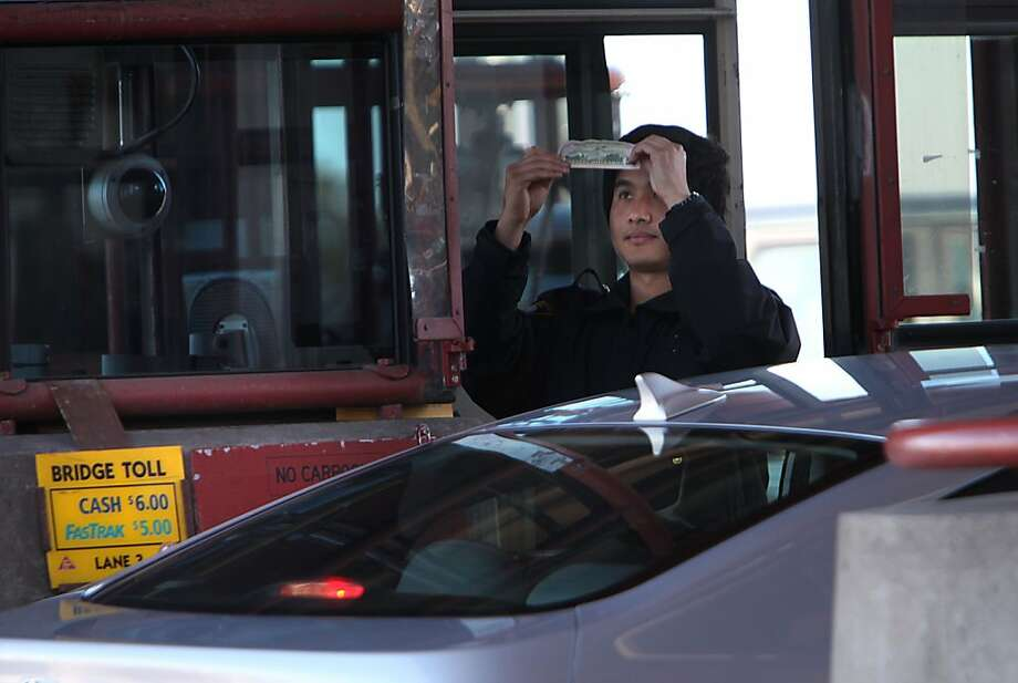 Charin Sae-Lee and other Golden Gate Bridge toll-takers will soon join the ranks of people who've lost jobs to automation. Photo: Liz Hafalia, The Chronicle