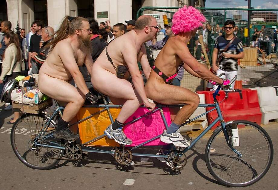 Three men take part in the annual London World Naked Bike Ride event in central London on June 11, 2011. Now in it's tenth year, the event has seen participation grow from 58 in 2004 to 1,200 in 2009. Taking a route that passes many of London's most famous landmarks, the ride allows those participating to decorate their body with messages of protest against oil dependancy and motor vehicle usage.