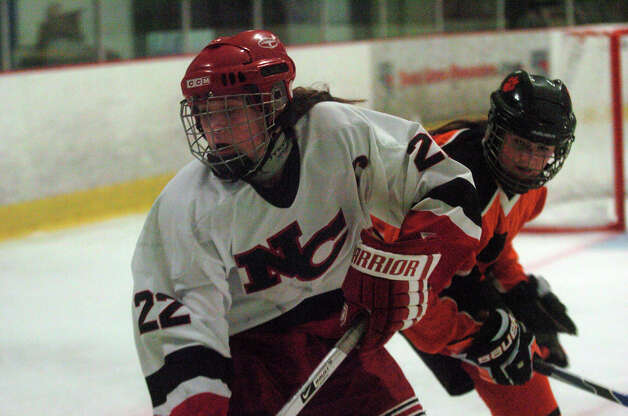 Olivia Hompe moves along the boards as New Canaan hosts Ridgefield High School in a girls hockey game at the Darien Ice Rink in Darien, Conn., Jan. 19, 2013. Photo: Keelin Daly / Stamford AdvocateRiverbendStamford, CT