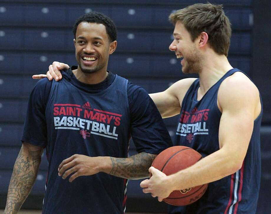 Paul McCoy (left), derailed by injury, and All-WCC guard Matthew Dellavedova each have admiration for what the other has accomplished. Photo: Mathew Sumner, Special To The Chronicle