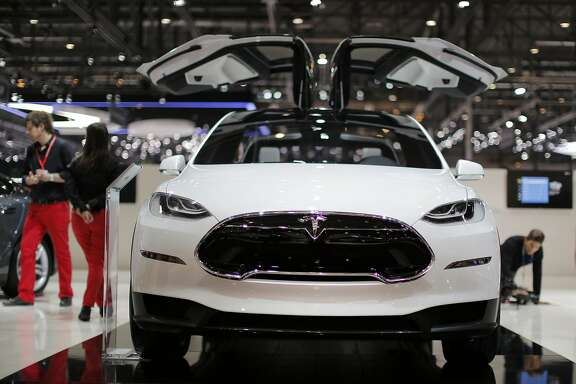 A Tesla Model X electric prototype automobile, produced by Tesla Motors Inc., is seen on display on the second day of the 83rd Geneva International Motor Show in Geneva, Switzerland, on Wednesday, March 6, 2013. This year's show opens to the public on Mar. 7, and is set to feature more than 100 product premiers from the world's automobile manufacturers. Photographer: Valentin Flauraud/Bloomberg