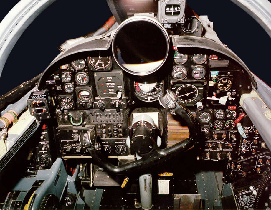 "The original U-2 spyplane cockpit used traditional dials and a large ""driftsight"" telescope to help the pilot see the landscape below. Photo: U.S. Air Force, Lockheed Martin Aeronautics Co."