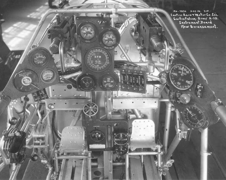 Cockpit of Curtiss A-3B, taken May 27, 1930. Note the center (primary) panel has water and oil temp,
