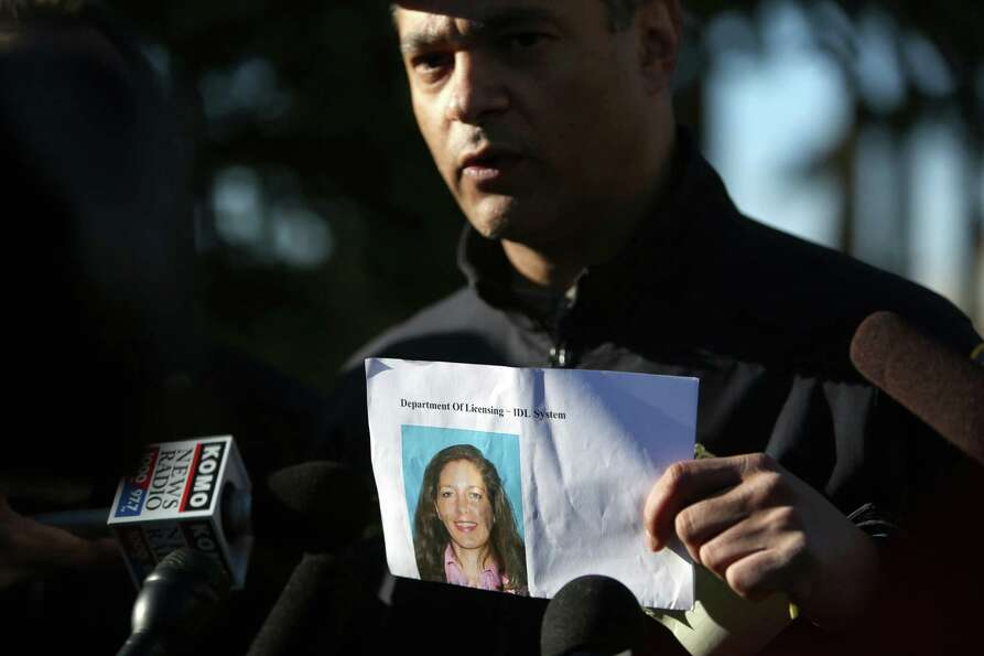 Seattle Police Department Assistant Chief Nick Metz holds a photo of suspect Carolyn Piksa, 47, duri