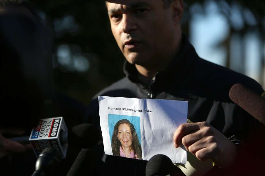 Seattle Police Department Assistant Chief Nick Metz holds a photo of suspect Carolyn Piksa, 47, during a briefing at the Bitter Lake Community Center after police say she shot a man at a Seattle Parks Department building on Friday, March 8, 2013.