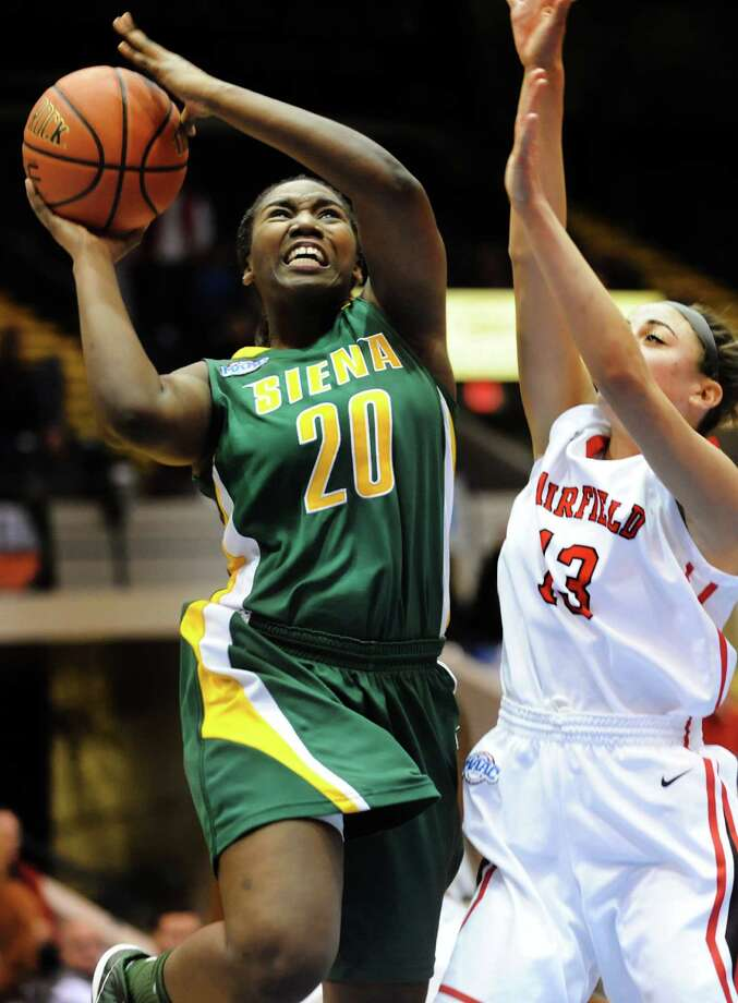 Siena's Kanika Cummings  (20), left, shoots for the hoop as Fairfield's Alexys Vazquez (13) defends during their quarterfinal MAAC Championship basketball game on Friday, March 8, 2013, in Springfield, Mass. (Cindy Schultz / Times Union) Photo: Cindy Schultz, Albany Times Union / ONLINE_YES