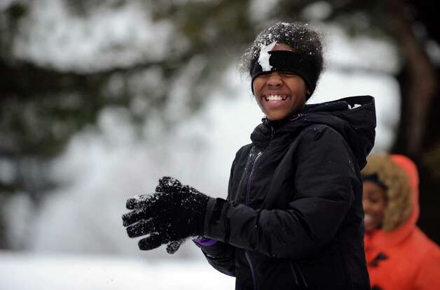 Janelle Johnson, 11, is all smiles during a snowball fight with friends in Bridgeport, Conn. Friday, Mar. 8, 2013. Photo: Autumn Driscoll