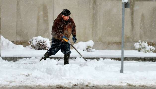 Danbury area residents dig out during Friday morning's snow, in Conn. March 8, 2013. Photo: Michael Duffy / The News-Times