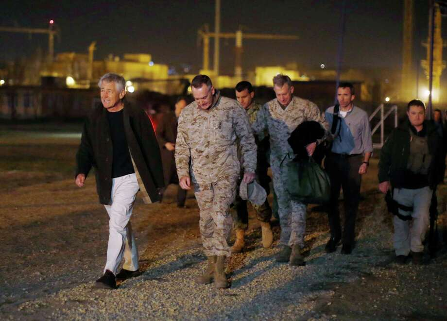 Defense Secretary Chuck Hagel, left, arrived in Afghanistan Friday for his first visit as Pentagon chief, saying that there are plenty of challenges ahead. Photo: Jason Reed, POOL / POOL Reuters