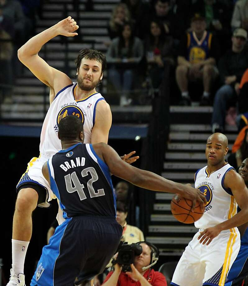 Golden State Warriors center Andrew Bogut (12) blocks Dallas Mavericks Elton Brand(42) from shooting in the second half of their NBA basketball game Thursday, Jan. 31, 2013 at the Oakland Coliseum in Oakland California. Warriors won 100-97. Photo: Lance Iversen, The Chronicle