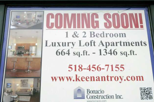 Sign advertising the new luxury loft apartment in the Keenan Building at Third Street and Broadway on Friday March 8, 2013 in Troy, N.Y. (Michael P. Farrell/Times Union) Photo: Michael P. Farrell