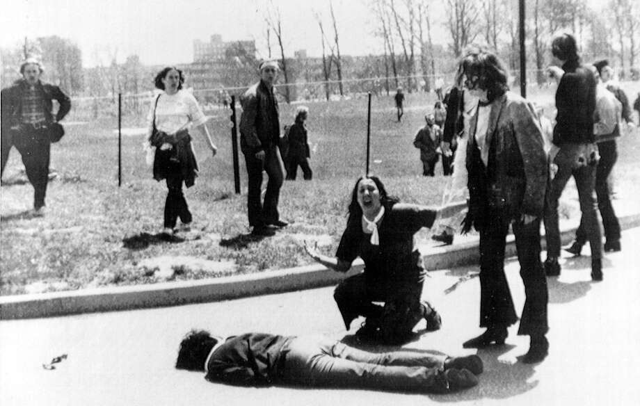 This Pulitzer Prize winning photo shows Mary Ann Vecchio, 14, screaming as she kneels over the body of student Jeffrey Miller at Kent State University on May 4, 1970. National Guardsmen had fired into a crowd of demonstrators, killing four and wounding nine. Photo: John Filo / Associated Press