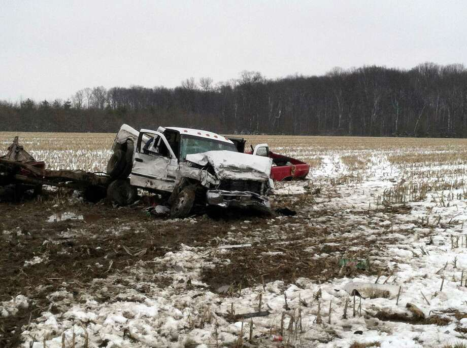 This photo provided by Indiana State Police  shows the scene of a crash between two pick trucks that killed three teenagers Thursday, March 7, 2013 near Versailles, Ind. Sgt. Noel Houze said during a news conference Thursday that the six students involved in the crash attended South Ripley County High School in Versailles, a small community about 45 miles west of Cincinnati. (AP Photo/Indiana State Police) Photo: Uncredited, HOPD / Indiana State Police
