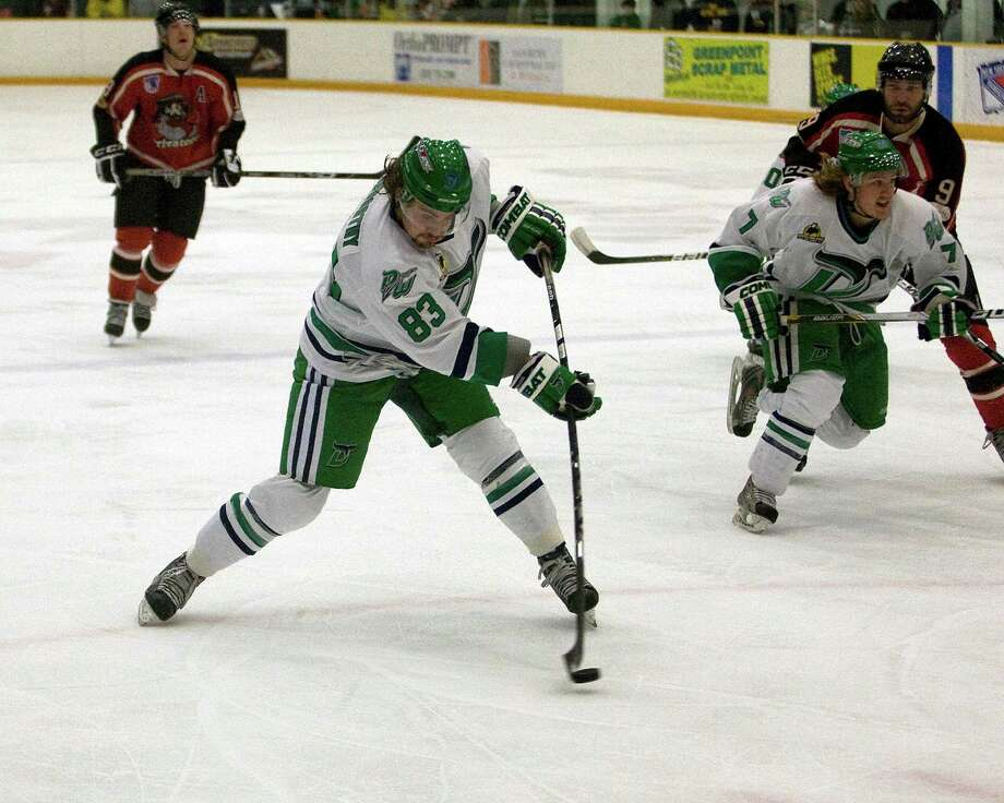 The Whalers' Tyler Noseworthy blasts a shot against the Thousand Islands Privateers during the opening game of the Federal Hockey League's playoff semifinals Friday night, Mar. 8. 2013, at the Danbury Arena. Photo: Barry Horn / The News-Times Freelance