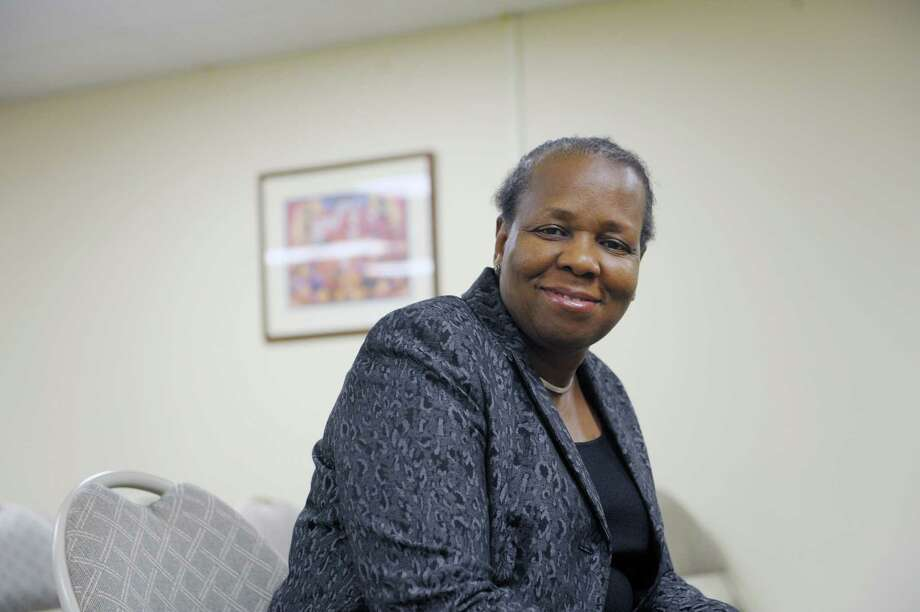Carolyn Williams, board member, poses inside one of the rooms at the God With Us Center on Tuesday, March 5, 2013 in Albany, NY.   (Paul Buckowski / Times Union) Photo: Paul Buckowski