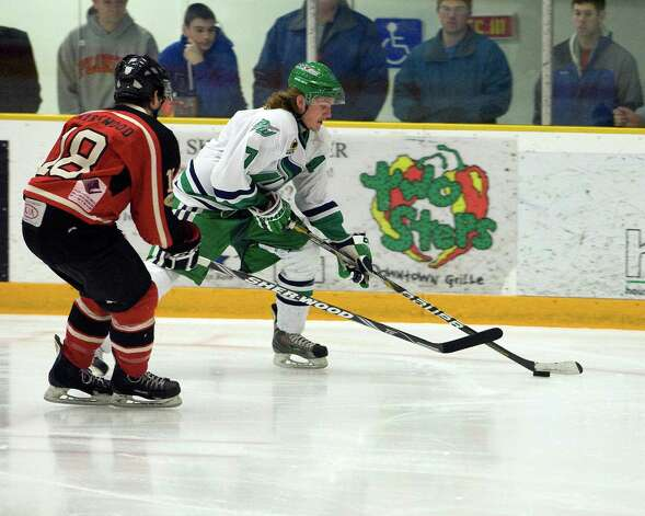 The Whalers' Mike Atkinson (7) tries to get around the Privateers' James Kirkwood in the first game of the FHL playoff semifinals Friday night, Mar. 8, 2013, at the Danbury Arena. Photo: Barry Horn / The News-Times Freelance