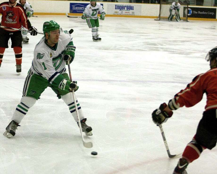 The Whalers' Philip Aucoin centers the puck against the Thousand Island Privateers during the FHL playoff semifinal opening game Friday night, Mar. 8, 2013, at the Danbury Arena. Photo: Barry Horn