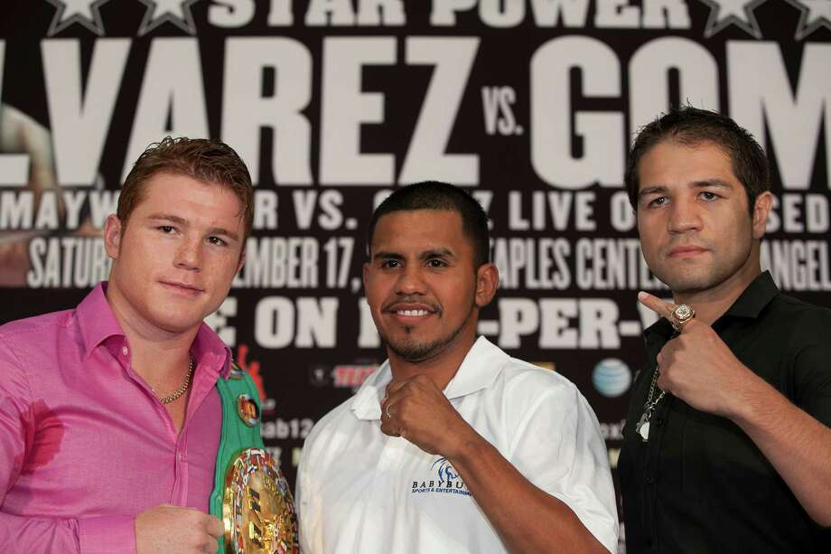 Former world lightweight champion Juan Diaz, center, makes an appearance with World Boxing Council super welterweight world champion Canelo Alvarez, left, and Alfonso Gomez, right, Wednesday noon July 27, 2011 at the PlazAmericas Hall in Houston. Alvarez anounced his fight with Gomez slated for Sept. 17 in Los Angeles.  Nathan Lindstrom/For the Chronicle  2010 Nathan Lindstrom Photo: Nathan Lindstrom, Freelance / ©2011 Nathan Lindstrom