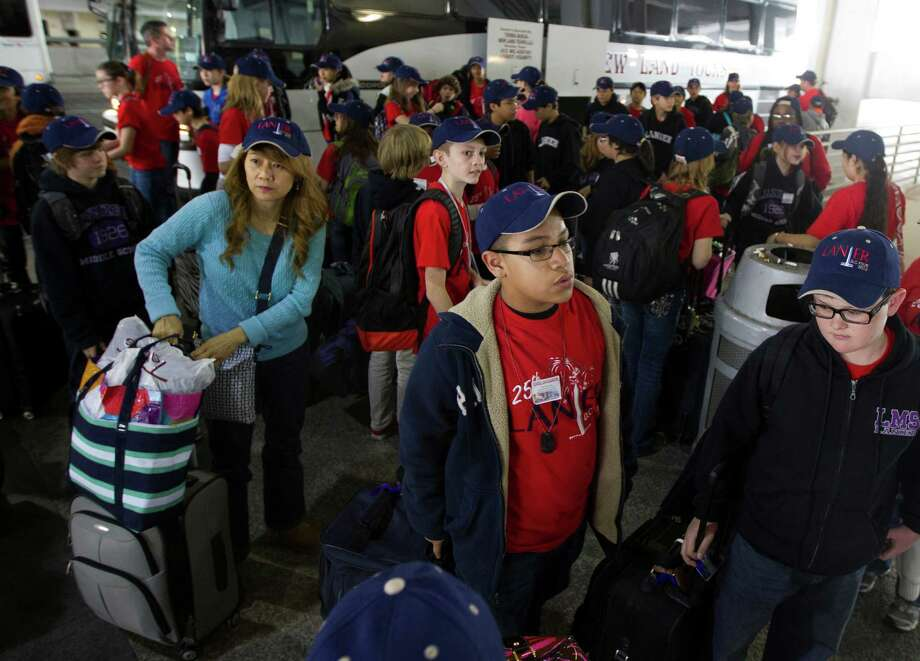 Sixth-grade students from Lanier Middle School arrive Friday at George Bush Intercontinental Airport for a flight to Washington, D.C. The group's White House tour had to be canceled due to sequester cuts. Photo: J. Patric Schneider, Freelance / © 2013 Houston Chronicle