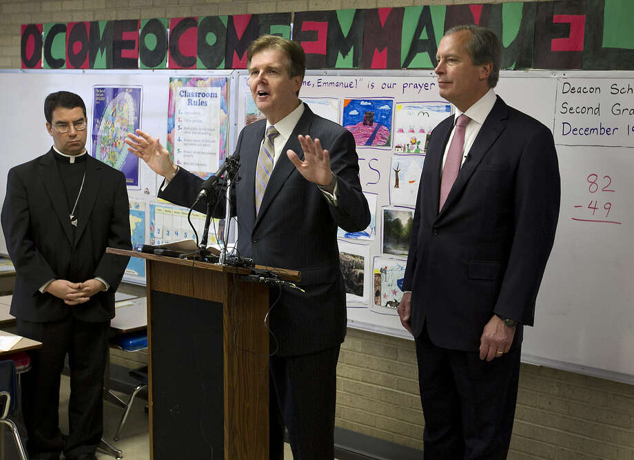 Texas Senate Education Chairman Dan Patrick (center) speaks recently at the Cathedral School of Saint Mary in Austin as Lt. Gov. David Dewhurst and Bishop Oscar Cantu listen. Photo: Associated Press
