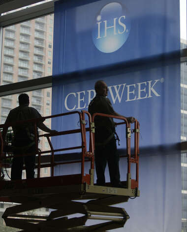 Banners are removed on the IHS CERAWeek conference's final day. Security at the event was high as bomb-sniffing dogs, bag searches and police stationed at escalators were common. Photo: Melissa Phillip / Houston Chronicle