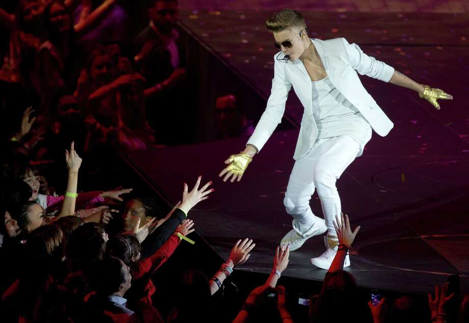 Justin Bieber performs Friday at the O2 Arena in London. Bieber was wrapping up a series of four concerts at the O2 before his Believe tour moves to Portugal for a Monday show. His world tour is scheduled to last until August. Photo: Joel Ryan, INVL / Invision