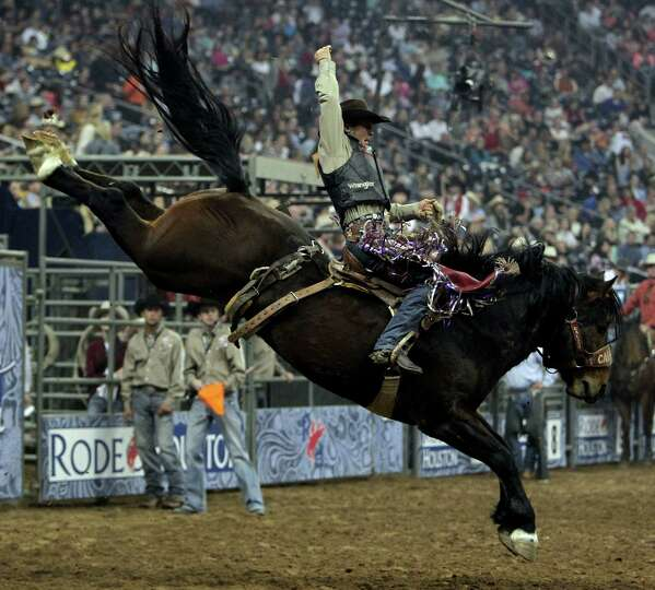 Cody Wright competes during the Saddle Bronc Riding competition at RodeoHouston in Reliant Stadium F