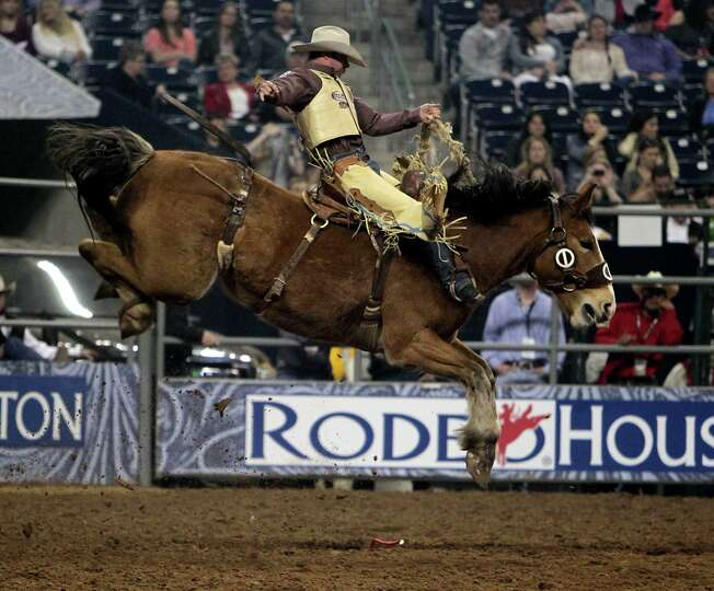 Chad Ferley competes during the Saddle Bronc Riding competition at RodeoHouston in Reliant Stadium F