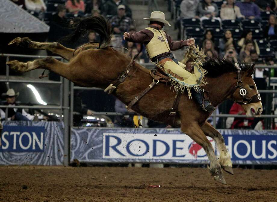 Chad Ferley competes during the Saddle Bronc Riding competition at RodeoHouston in Reliant Stadium Friday, March 8, 2013, in Houston. Photo: James Nielsen, Houston Chronicle / © 2013  Houston Chronicle