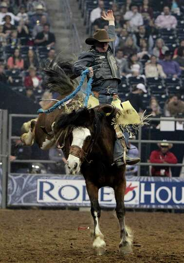 Mert Bradshaw competes during the Saddle Bronc Riding competition at RodeoHouston in Reliant Stadium