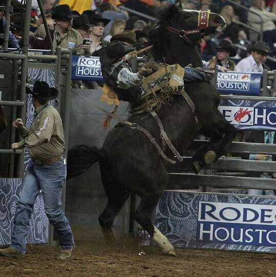 Luke Butterfield competes during the Saddle Bronc Riding competition at RodeoHouston in Reliant Stad