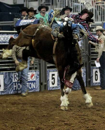 Cain Riddle competes during the Bareback Riding competition at RodeoHouston in Reliant Stadium Frida