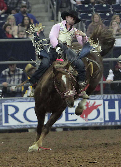 Matthew Smith competes during the Bareback Riding competition at RodeoHouston in Reliant Stadium Fri