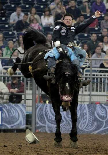 Clint Cannon competes during the Bareback Riding competition at RodeoHouston in Reliant Stadium Frid