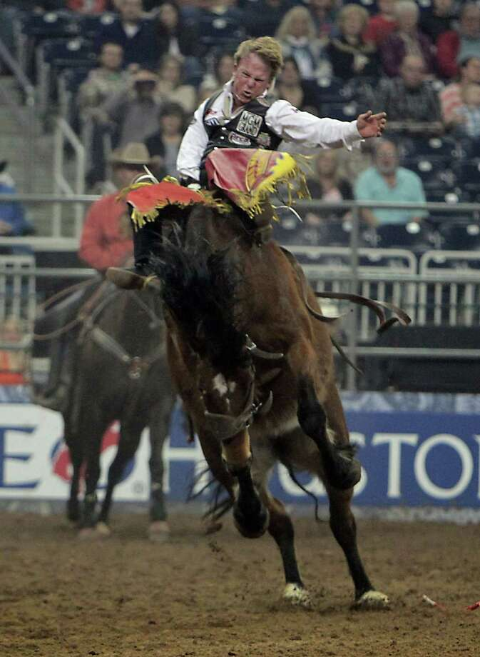 Wes Stevenson competes during the Bareback Riding competition at RodeoHouston in Reliant Stadium Friday, March 8, 2013, in Houston. Photo: James Nielsen, Houston Chronicle / © 2013  Houston Chronicle