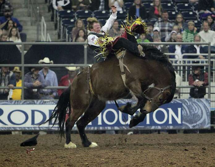 Wes Stevenson competes during the Bareback Riding competition at RodeoHouston in Reliant Stadium Fri