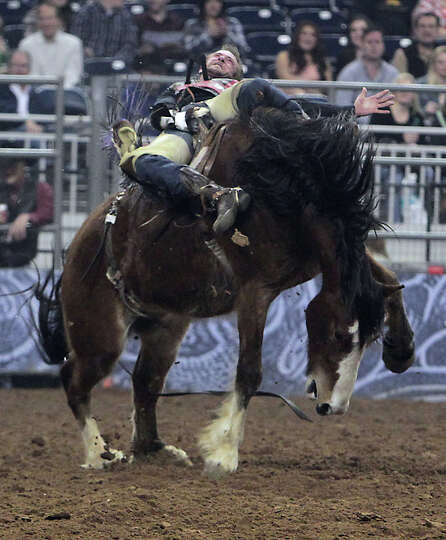 Tom McFarland competes during the Bareback Riding competition at RodeoHouston in Reliant Stadium Fri