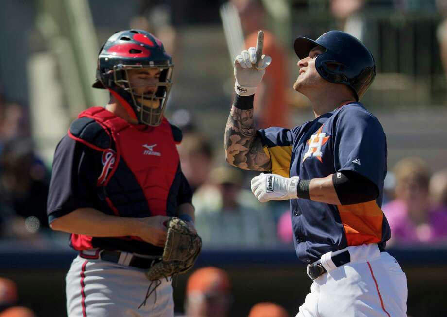 Brandon Barnes, right, was one of the few bright spots for the Astros, who fell behind by 13 runs and could never catch up in a loss to the Braves on Friday. Photo: Evan Vucci, STF / AP