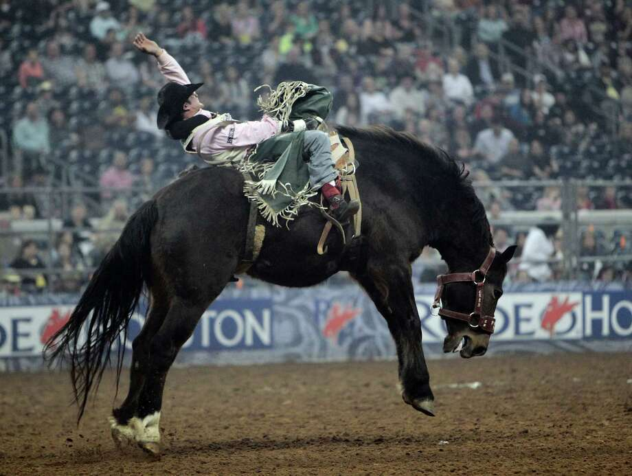 Jared Smith competes during the Bareback Riding competition at RodeoHouston in Reliant Stadium Friday, March 8, 2013, in Houston. Photo: James Nielsen, Houston Chronicle / © 2013  Houston Chronicle