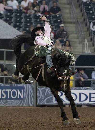 Jared Smith competes during the Bareback Riding competition at RodeoHouston in Reliant Stadium Frida