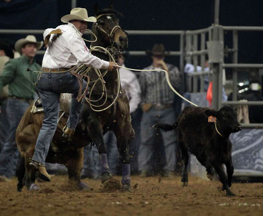 Blair Burk competes during the Tie-Down Roping competition at RodeoHouston in Reliant Stadium Friday, March 8, 2013, in Houston. Photo: James Nielsen, Houston Chronicle / © 2013  Houston Chronicle