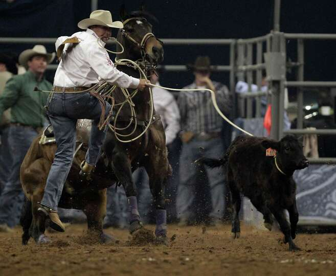 Blair Burk competes during the Tie-Down Roping competition at RodeoHouston in Reliant Stadium Friday