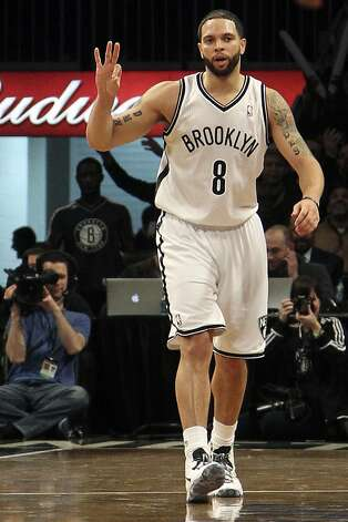 Brooklyn Nets' Deron Williams gestures after scoring a 3-point basket during the first half of NBA basketball game against the Washington Wizards, Friday, March 8, 2013, in New York. (AP Photo/Mary Altaffer) Photo: Mary Altaffer, Associated Press