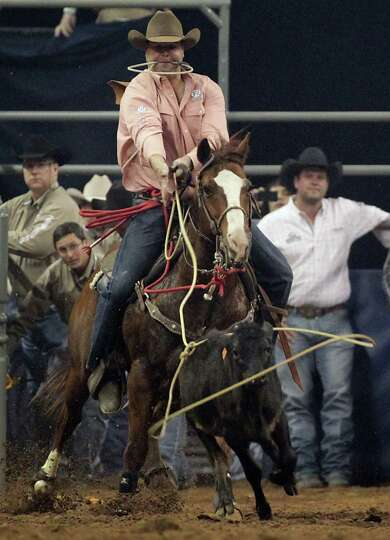 Jerrad Hofstetter competes during the Tie-Down Roping competition at RodeoHouston in Reliant Stadium