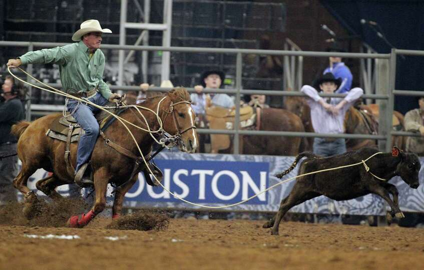 Ryan Watkins competes during the Tie-Down Roping competition at RodeoHouston in Reliant Stadium Frid