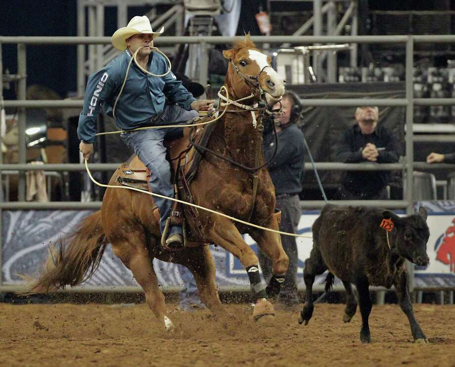 Scott Kormos competes during the Tie-Down Roping competition at RodeoHouston in Reliant Stadium Friday, March 8, 2013, in Houston. Photo: James Nielsen, Houston Chronicle / © 2013  Houston Chronicle