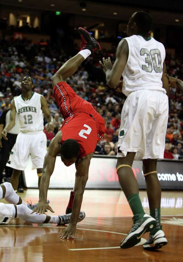 Travis' Aaron Harrison (2) takes a tumble as he went for the basket during the first half. Photo: Karen Warren, Houston Chronicle / © 2013 Houston Chronicle