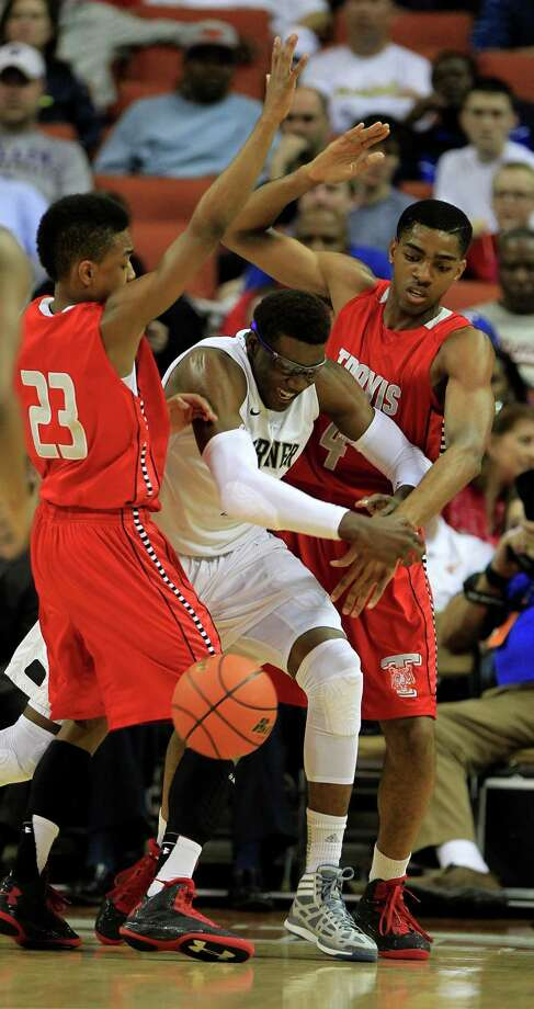 Berkner's Soma Edo (2) is surrounded by Travis' Tyronne Jordan and Daniel Chika (4) during the first half of the UIL 5A boys state basketball semifinal game between Fort Bend Travis and Richardson Berkner at the Frank Erwin Center, Friday, March 8, 2013, in Austin. Photo: Karen Warren, Houston Chronicle / © 2013 Houston Chronicle